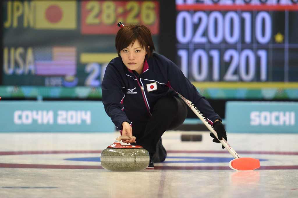 . Japan\'s Ayumi Ogasawara throws the stone during the Women\'s Curling Round Robin Session 6 Japan vs USA at the Ice Cube Curling Center during the Sochi Winter Olympics on February 13, 2014. DAMIEN MEYER/AFP/Getty Images