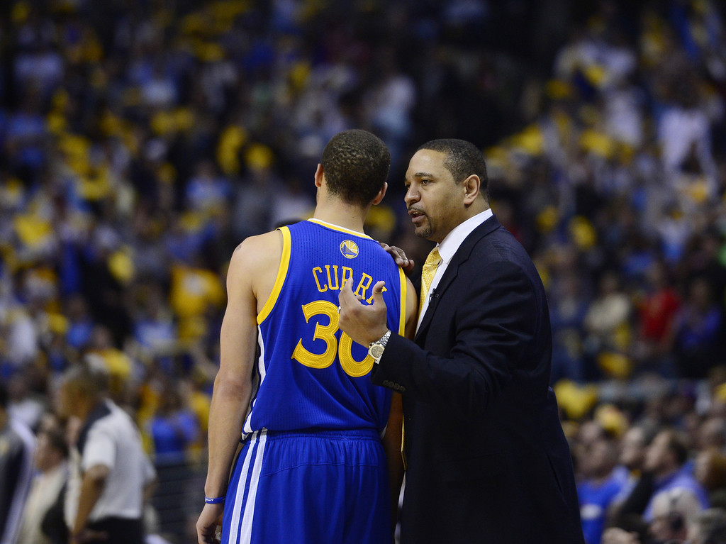 . Golden State Warriors head coach Mark Jackson talks with Golden State Warriors point guard Stephen Curry (30) in the fourth quarter. The Denver Nuggets took on the Golden State Warriors in Game 5 of the Western Conference First Round Series at the Pepsi Center in Denver, Colo. on April 30, 2013. (Photo by AAron Ontiveroz/The Denver Post)