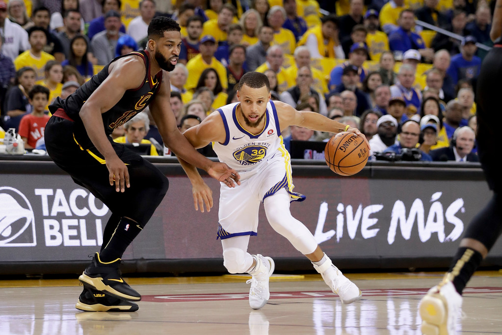 . Golden State Warriors guard Stephen Curry (30) drives against Cleveland Cavaliers center Tristan Thompson during the first half of Game 1 of basketball\'s NBA Finals in Oakland, Calif., Thursday, May 31, 2018. (AP Photo/Marcio Jose Sanchez)