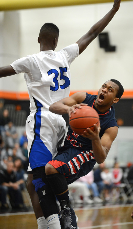 . Dublin High\'s Cameron Moses (2) is fouled by Newark Memorial High\'s Matthew Thomas (35) in their North Coast Section Division II high school boys championship game played at Washington High School in Fremont, Calif. on Friday, March 1, 2013. (Dan Honda/Staff)