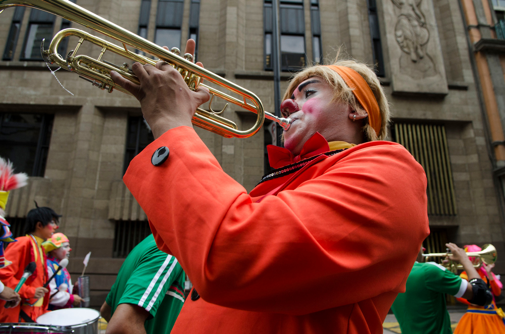 . A trumpet-playing circus clown participates in a protest against approved legislation that bans the use of animals in circuses, in Mexico City, Thursday, June 26, 2014. Circus performers in Mexico City fear that without their animals they will not survive because they believe people won�t want to come to only see the clowns, the acrobats and trapeze artists. (AP Photo/Sean Havey)