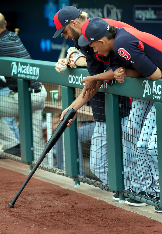 . Cleveland Indians\' Erik Gonzalez (9) watches as Danny Salazar uses a bat to draw in the dirt before a baseball game against the Kansas City Royals at Kauffman Stadium in Kansas City, Mo., Friday, June 2, 2017. (AP Photo/Orlin Wagner)
