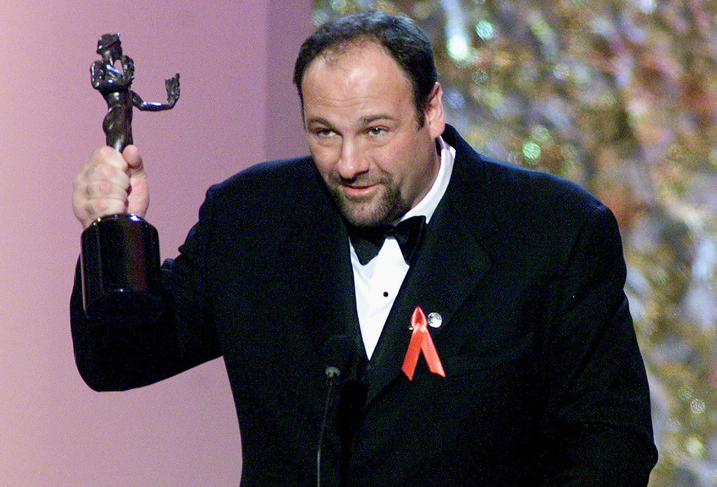 """. In this 12 March 2000 file photo, US actor James Gandolfini accepts the award for best actor in a television drama series for his role in \""""The Sopranos\"""" at the Sixth Annual Screen Actors Guild Awards (SAG) in Los Angeles.      LUCY NICHOLSON/AFP/Getty Images"""
