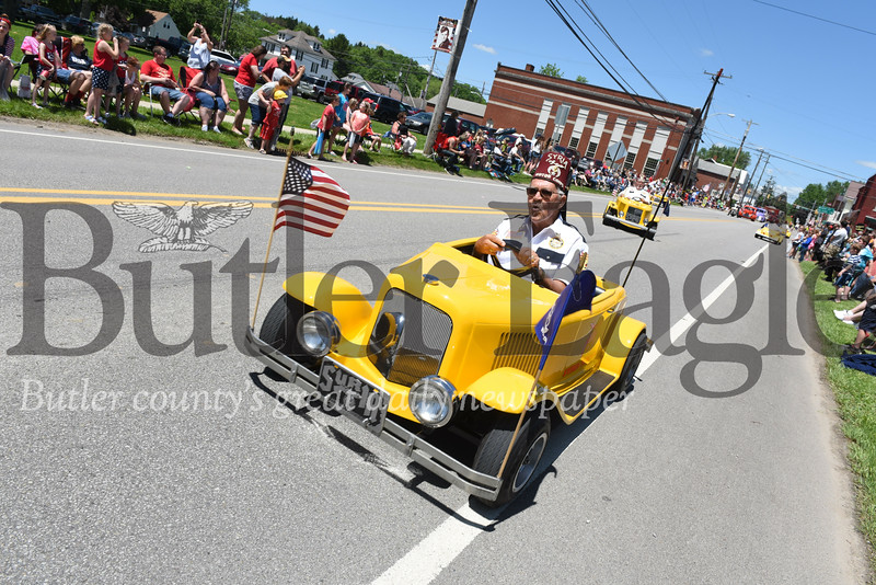 Harold Aughton/Butler Eagle: Members of the Shriners Motor Corp entertained the crowd with their car tricks during the Harrisville Memorial Day parade Monday afternoon, May 27.