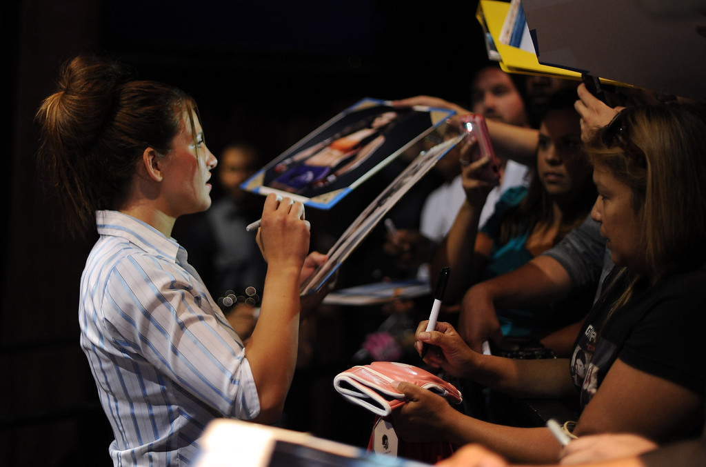 . UFC fighter Miesha Tate signs autographs during the UFC World Tour at Club Nokia Tuesday, July 30, 2013 in Los Angeles. (Hans Gutknecht/Los Angeles Daily News)
