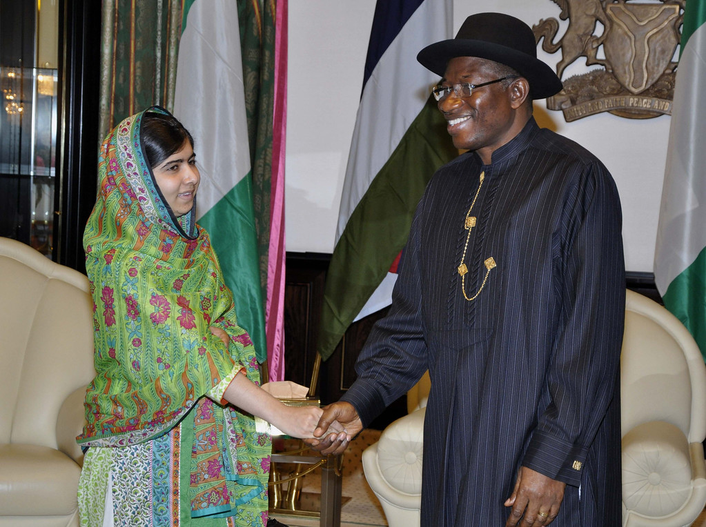 """. File photo dated  Monday, July 14, 2014, Pakistani activist Malala Yousafzai shakes hands with Nigerian President Goodluck Jonathan, at the Presidential villa, in Abuja, Nigeria. Yousafzai on Monday won a promise from Nigeriaís leader to meet with the parents of some of the 219 schoolgirls held by Islamic extremists for three months. Malala celebrated her 17th birthday on Monday in Nigeria with promises to work for the release of the girls from the Boko Haram movement. Teenage activist Malala Yousafzai has jointly won the Nobel Peace Prize for her \""""heroic struggle\"""" for girls\' rights to education, it is announced Friday Oct. 10, 2014.  (AP Photo/FILE)"""