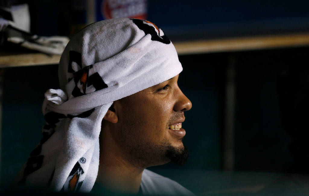. Chicago White Sox first baseman Jose Abreu watches from the dugout against the Detroit Tigers in the fourth inning of a baseball game in Detroit Monday, Sept. 22, 2014. (AP Photo/Paul Sancya)
