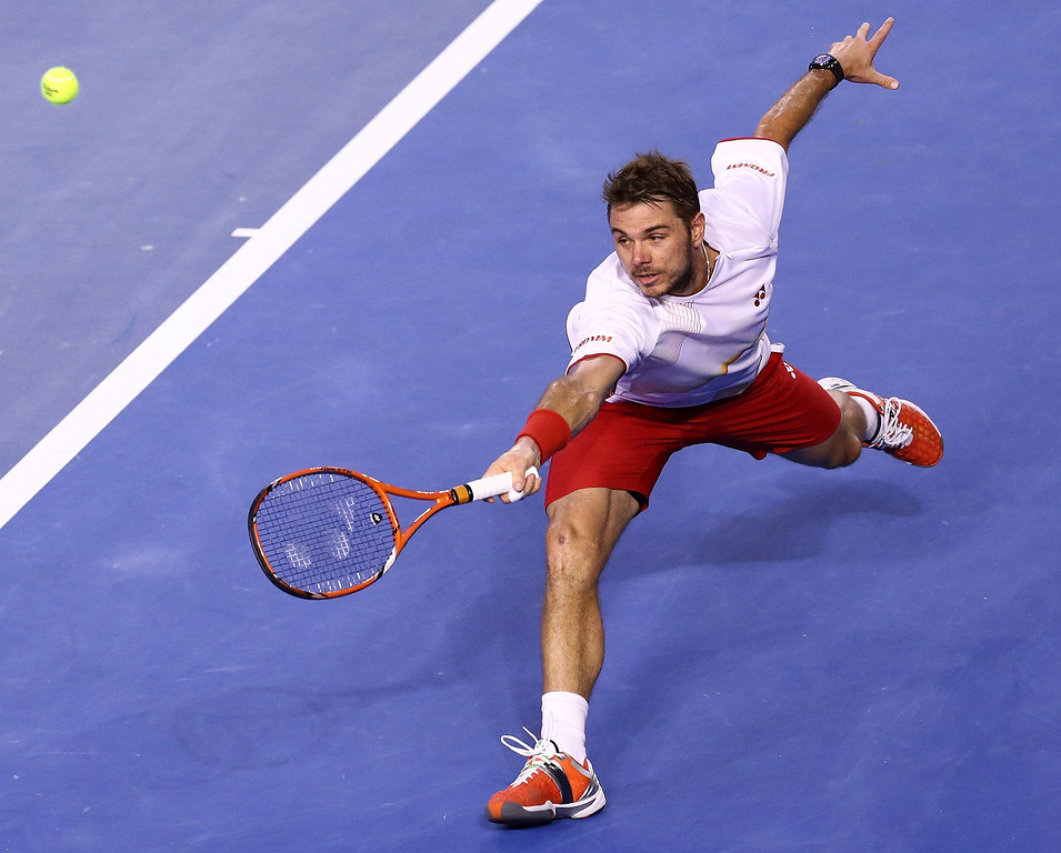 . Stanislas Wawrinka of Switzerland plays a backhand in his men\'s final match against Rafael Nadal of Spain during day 14 of the 2014 Australian Open at Melbourne Park on January 26, 2014 in Melbourne, Australia.  (Photo by Matt King/Getty Images)