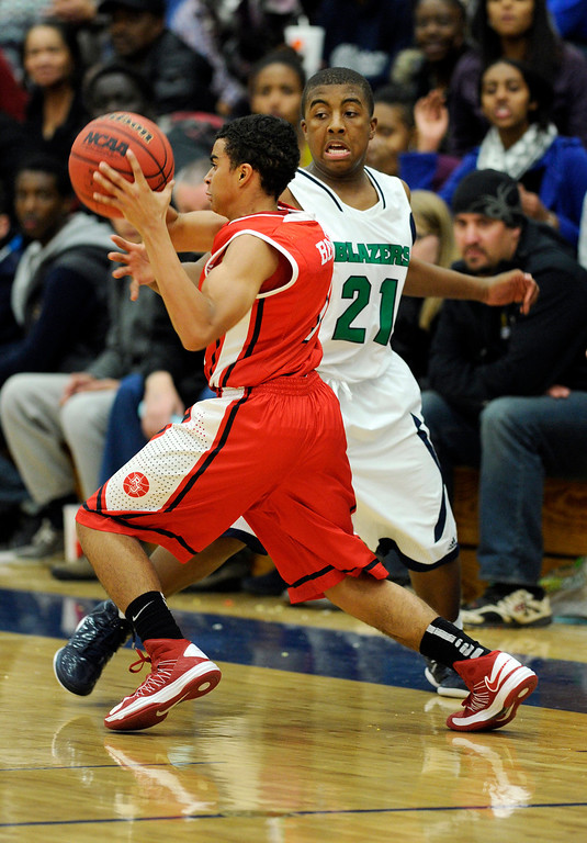 . Regis guard Cam Beards (1) went around Blazers guard Reginald Gibson (21) in the second half. The Overland High School boy\'s basketball team defeated Regis Jesuit 80-66 Tuesday night, December 11, 2012.  Karl Gehring/The Denver Post