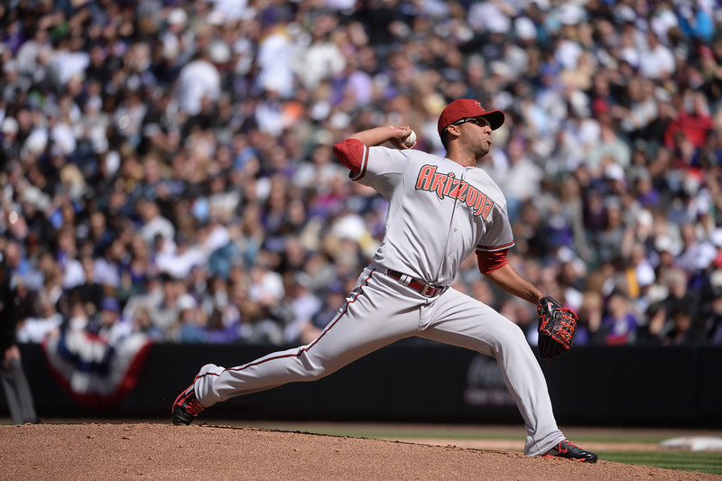 . The Arizona Diamondbacks\' Randall Delgado (48) pitches during the third inning. The Colorado Rockies hosted the Arizona Diamondbacks in the Rockies season home opener at Coors Field in Denver, Colorado Friday, April 4, 2014. (Photo by Karl Gehring/The Denver Post)