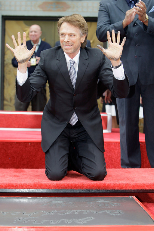 ". Movie and television producer Jerry Bruckheimer adds his hand and footprints to some 200 other celebrity impressions in the forecourt of Grauman\'s Chinese Theatre in the Hollywood district of Los Angeles Monday, May 17, 2010.  The ceremony comes 11 days before the release of Bruckheimer\'s latest film, ""Prince of Persia: The Sands of Time.\""  Bruckheimer\'s films have earned worldwide revenues of more than $15 billion in box office, home entertainment and music receipts and have garnered 41 Academy Award nominations and six Oscars.  (AP Photo/Reed Saxon)"