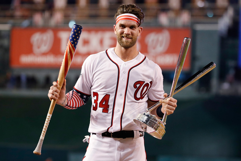 . Washington Nationals Bryce Harper (34) holds his bat and the trophy after winning the Major League Baseball Home Run Derby Monday, July 16, 2018 in Washington. (AP Photo/Alex Brandon)