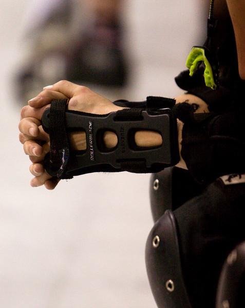 the hands of a roller-derby skater.