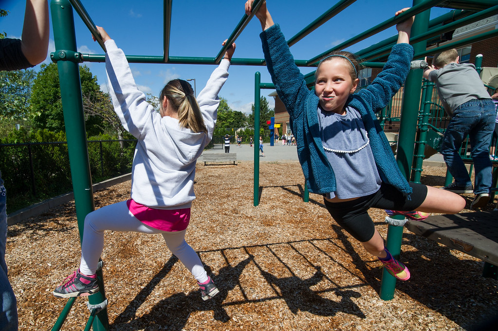 . 4th graders Kyla WIlson (left) and Olivia Puczynski play on the monkey bars during recess at the Westminster Elementary School on Friday, Sept. 8, 2017.  SENTINEL & ENTERPRISE JEFF PORTER