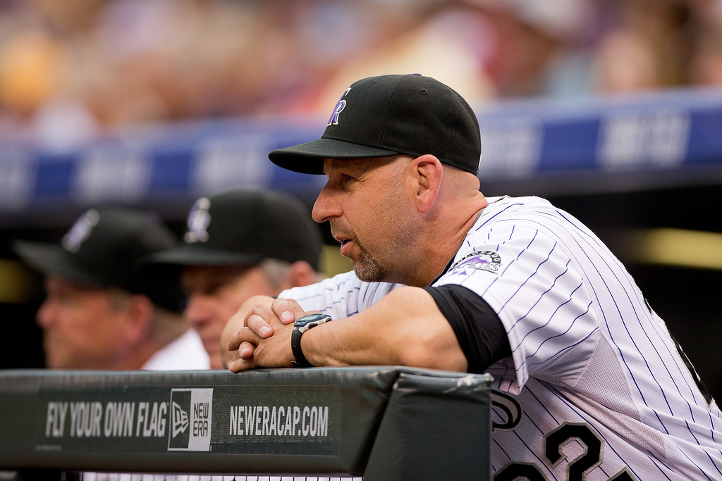. Manager Walt Weiss of the Colorado Rockies looks on from the dugout during the first inning against the Los Angeles Dodgers at Coors Field on July 3, 2014 in Denver, Colorado.  (Photo by Justin Edmonds/Getty Images)