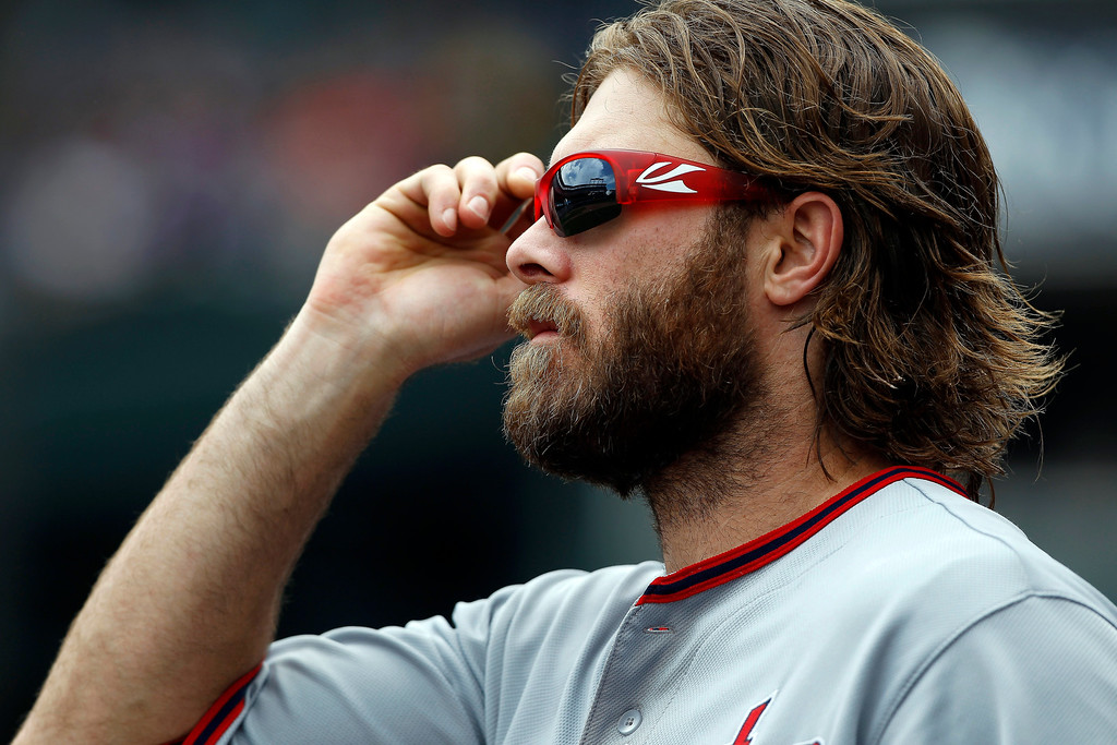 . Washington Nationals right fielder Jayson Werth puts on his sunglasses as he heads out to his position  in the fifth inning of a baseball game against the Colorado Rockies Thursday, June 13, 2013, in Denver. (AP Photo/David Zalubowski)