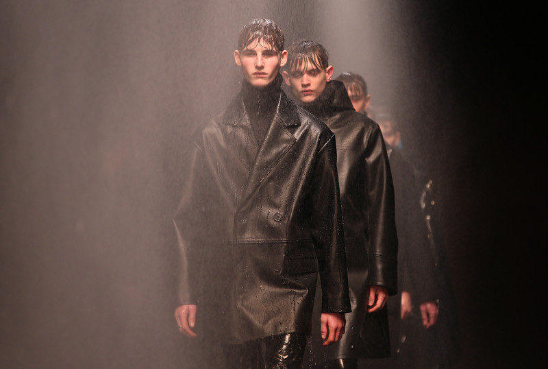 . Models walk through water spray as they wear designs created by Topman Design during London Collections for Men Autumn/Winter 2014, at the Old Sorting Office in central London, Monday, Jan. 6, 2014. (Joel Ryan/Invision/AP)
