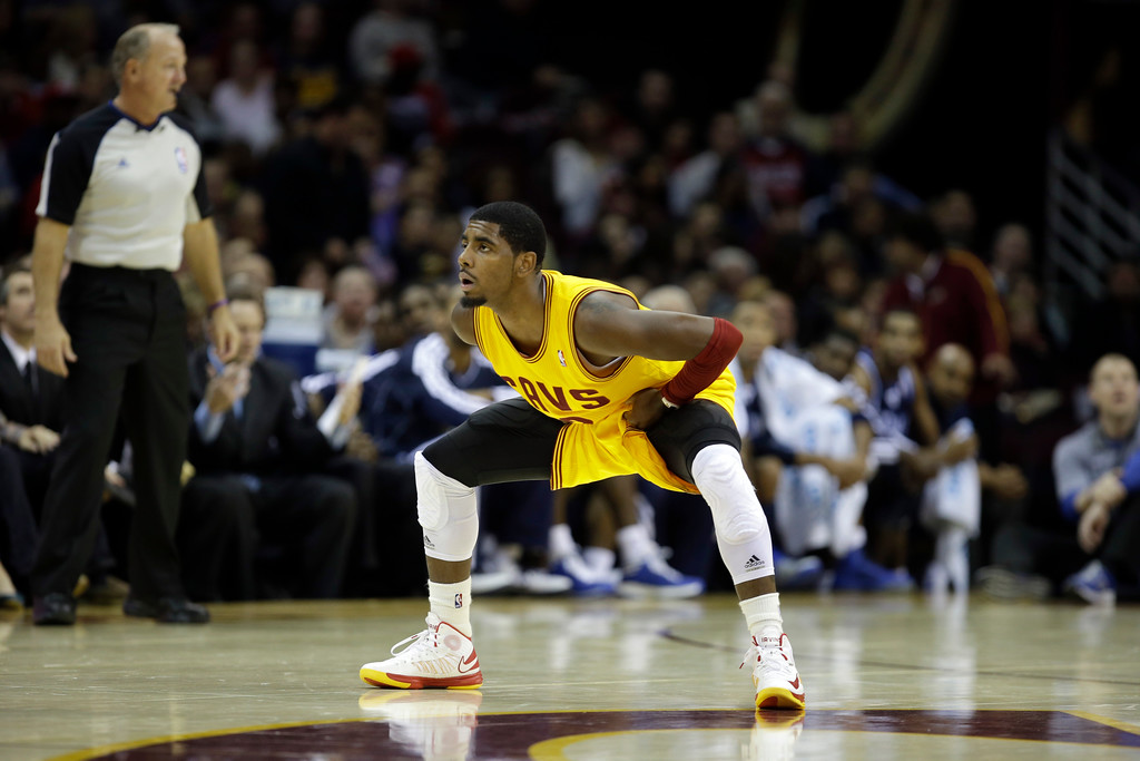 . Cleveland Cavaliers\' Kyrie Irving defends in  an NBA basketball game against the Dallas Mavericks Saturday, Nov. 17, 2012, in Cleveland. (AP Photo/Mark Duncan)