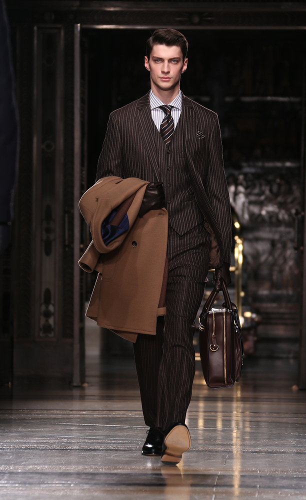 . A model wears a design created by Hackett during London Collections for Men Autumn/Winter 2014, at Freemason\'s Hall in central London, Tuesday, Jan. 7, 2014. (Joel Ryan/Invision/AP)