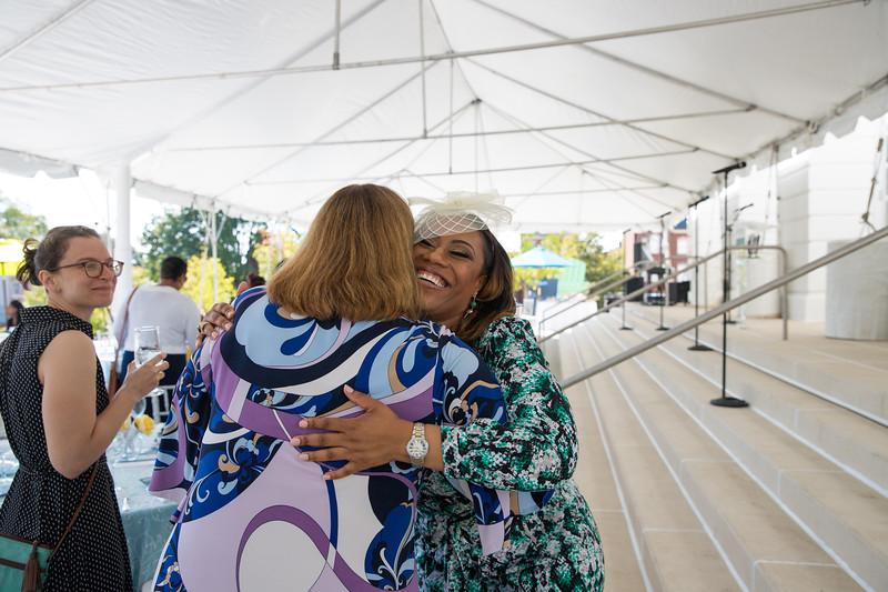 Dr. Kristy Arnold hugs friend. photo by Bruce Allen. LIFT Jazz Brunch