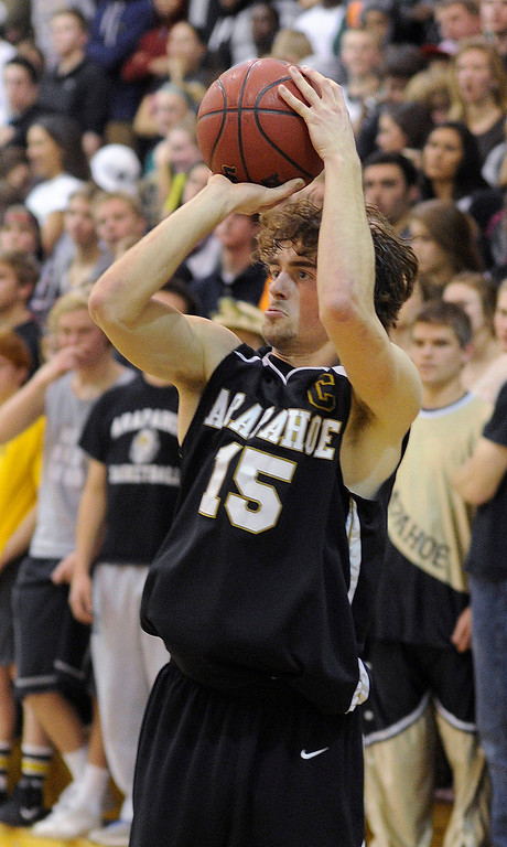 . Warriors forward Taven Sparks (15) put up a shot from outside in the second half. The Mountain Vista High School boy\'s basketball team defeated Arapahoe 69-54 Friday night January 4, 2013.  Karl Gehring/The Denver Post