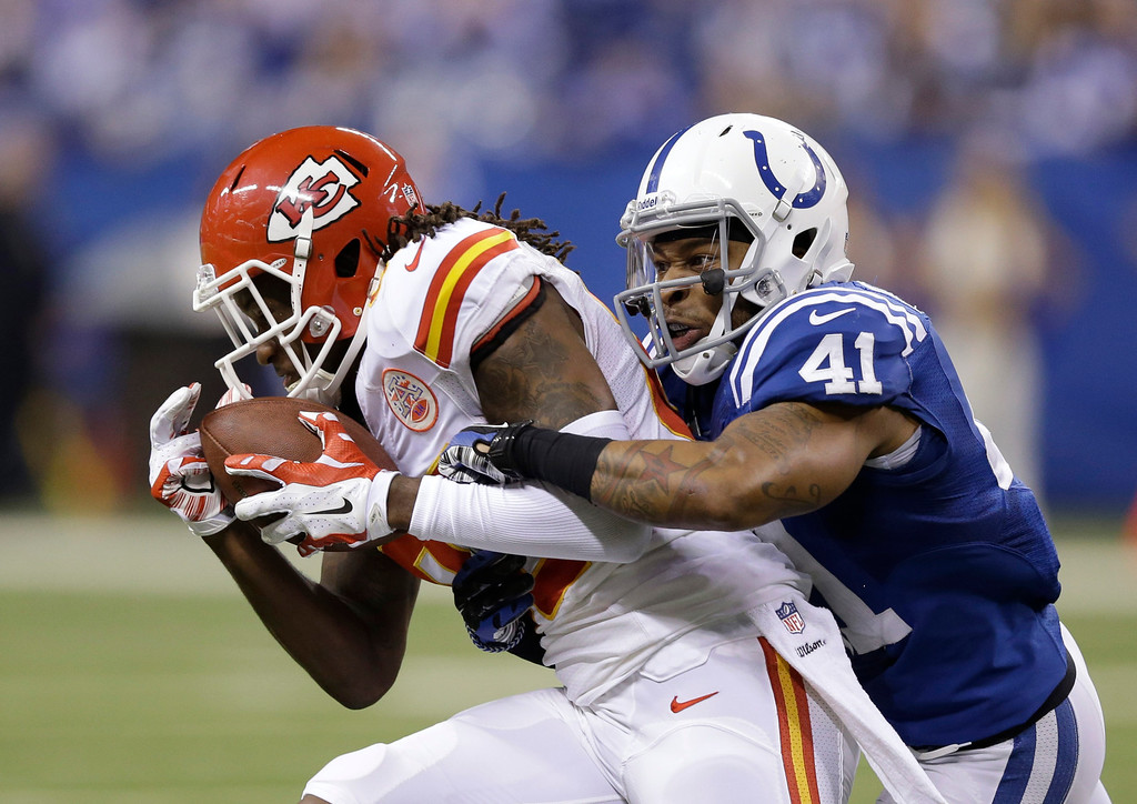 . Kansas City Chiefs\' Junior Hemingway (88) is tackled by Indianapolis Colts\' Antoine Bethea (41) during the second half of an NFL wild-card playoff football game Saturday, Jan. 4, 2014, in Indianapolis. (AP Photo/Michael Conroy)