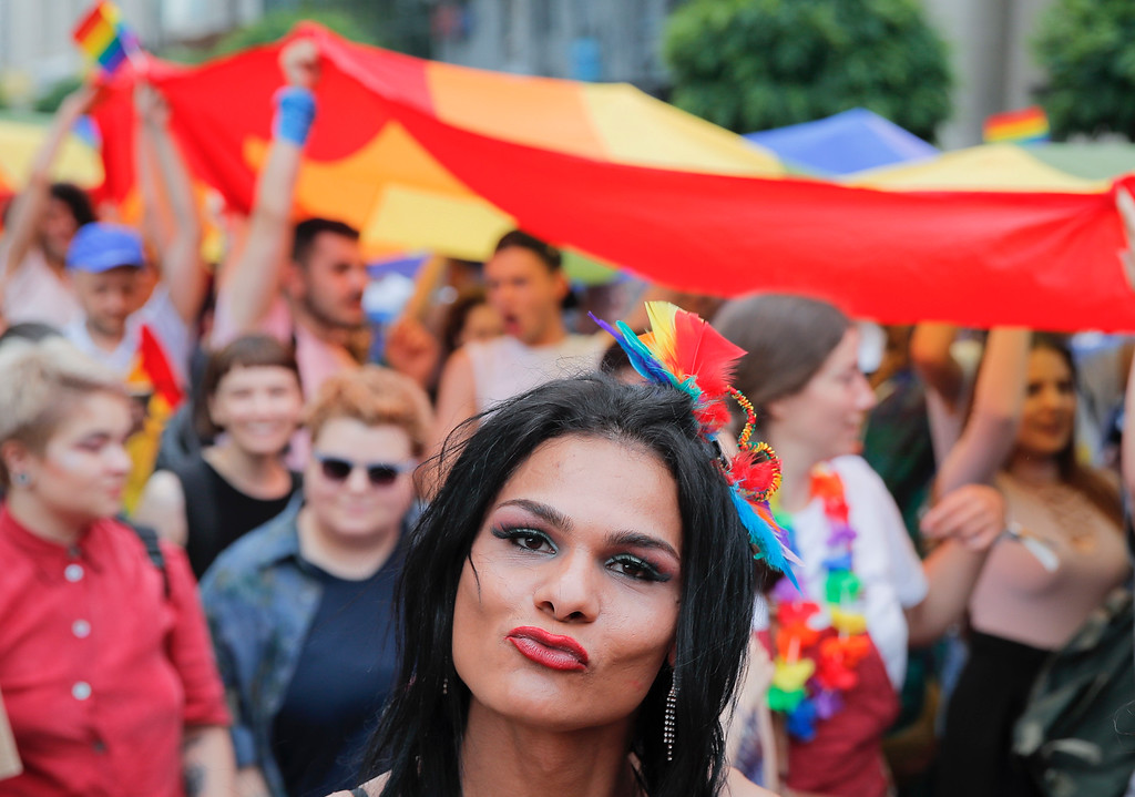 . A participant blows a kiss during the gay pride parade in Bucharest, Romania, Saturday, June 9, 2018. People taking part in the gay pride parade in the Romanian capital demanded more rights and acceptance for same-sex couples. (AP Photo/Vadim Ghirda)