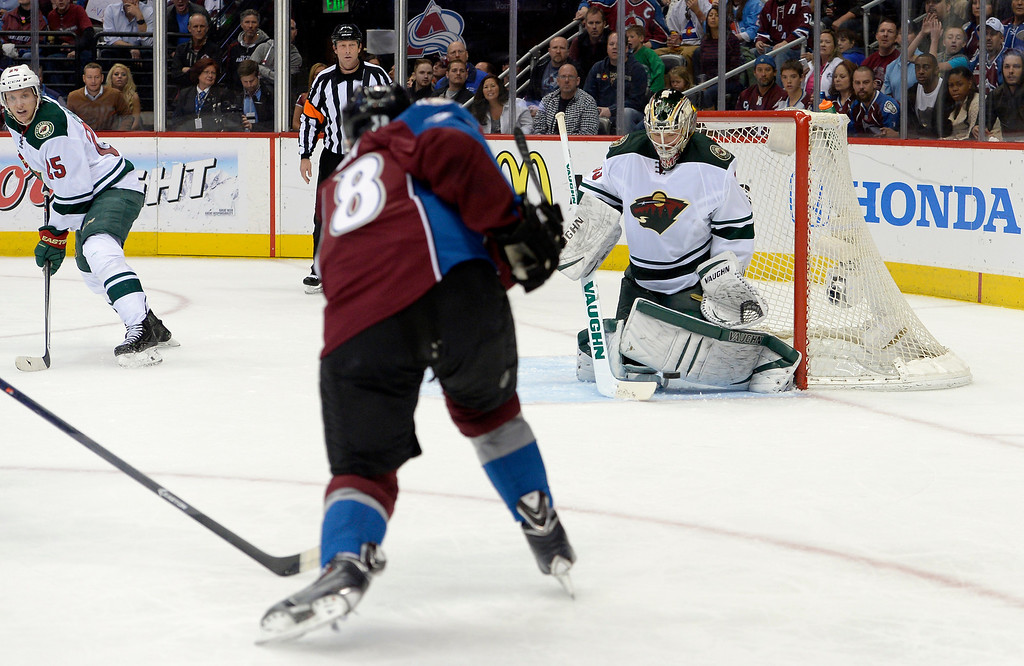. DENVER, CO - APRIL 26: Minnesota Wild goalie Darcy Kuemper (35) makes a pad save from a Colorado Avalanche center Joey Hishon (38) shot during the second period of action. The Colorado Avalanche hosted the Minnesota Wild in the fifth round of the Stanley Cup Playoffs at the Pepsi Center in Denver, Colorado on Saturday, April 26, 2014. (Photo by John Leyba/The Denver Post)