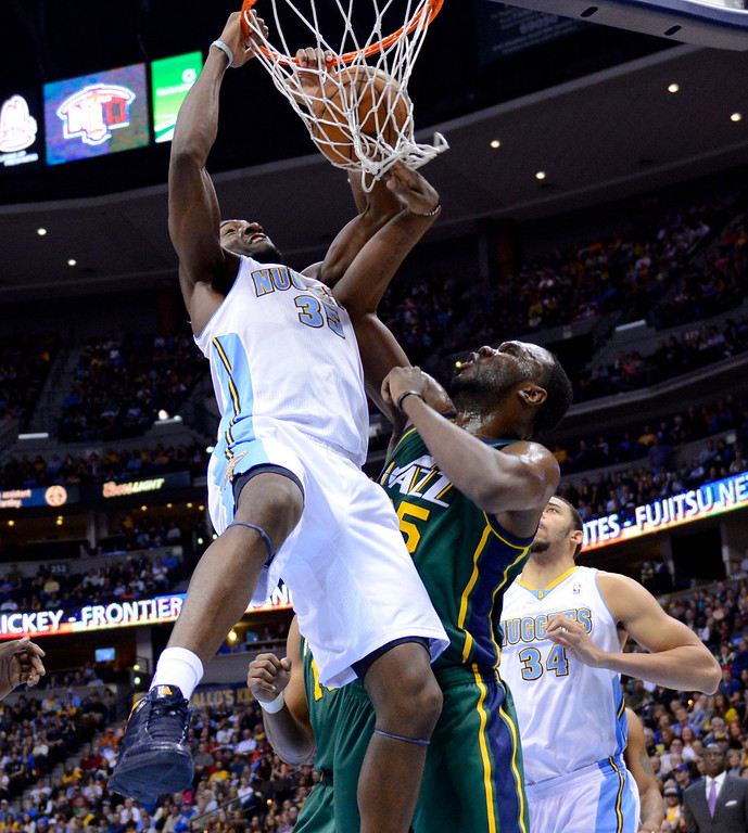 . Denver Nuggets forward Kenneth Faried (35) dunks over Utah Jazz center Al Jefferson (25) during the first quarter of an NBA basketball game on Saturday, Jan. 5, 2013, in Denver (AP Photo/Jack Dempsey)