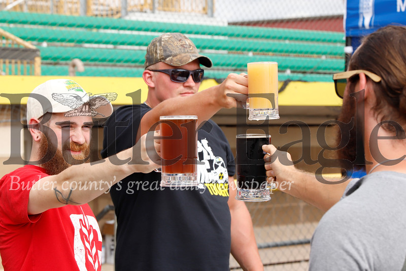 Phineas Record (left) of Butler and Matt Hileman of Kittaning hold beers high in a stein hoisting competition hosted by Missing Links Brewery at 2019 Fall Fest at Michelle Krill Field at Pullman Park. The person who could hold their arm extended with stein in hand wins. Hileman held on to win. Seb Foltz/Butler Eagle