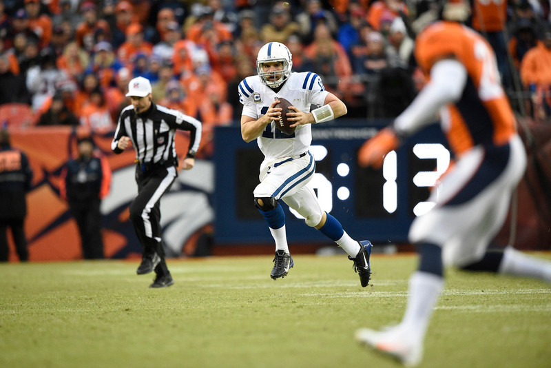 . Andrew Luck (12) of the Indianapolis Colts scrambles from the pocket in the second quarter. The Denver Broncos played the Indianapolis Colts in an AFC divisional playoff game at Sports Authority Field at Mile High in Denver on January 11, 2015. (Photo by John Leyba/The Denver Post)