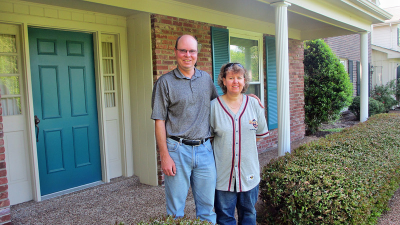 Mark and Megan Lindner in front of my home