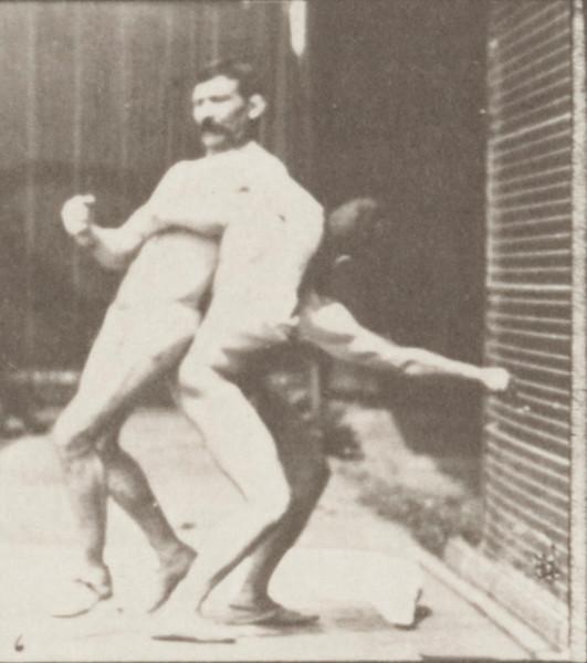 Two men in thong underwear boxing cross-buttocks