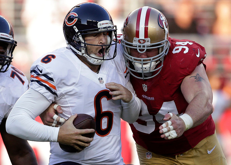 . San Francisco 49ers defensive tackle Justin Smith (94) sacks Chicago Bears quarterback Jay Cutler (6) during the second quarter of an NFL football game in Santa Clara, Calif., Sunday, Sept. 14, 2014. (AP Photo/Marcio Jose Sanchez)