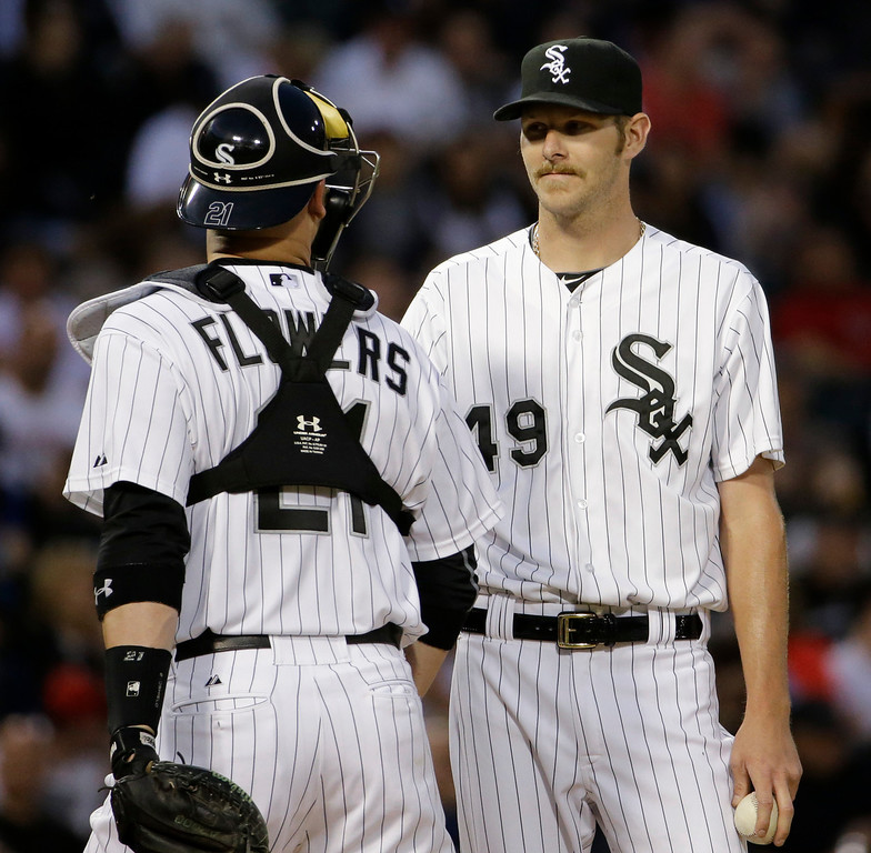 . Chicago White Sox starter Chris Sale, right, listens to catcher Tyler Flowers during the fifth inning of a baseball game against the Detroit Tigers in Chicago, Thursday, June 12, 2014. (AP Photo/Nam Y. Huh)