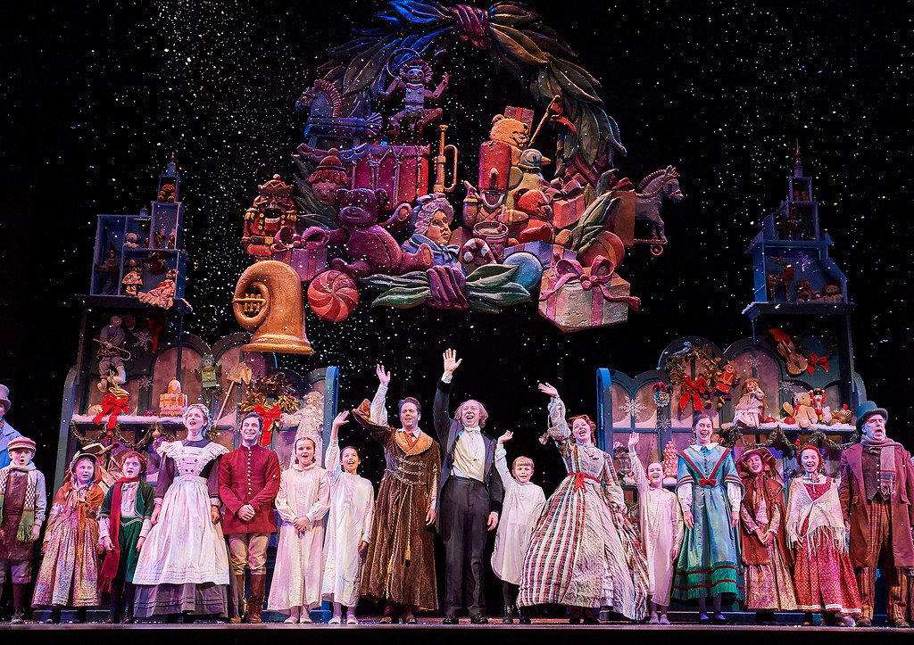 . The cast of Great Lakes Theater�s production of �A Christmas Carol� celebrates the end of a performance. The show continues through Dec. 23 at Playhouse Square�s Ohio Theatre. For more information, visit www.greatlakestheater.org. (Roger Mastroianni)