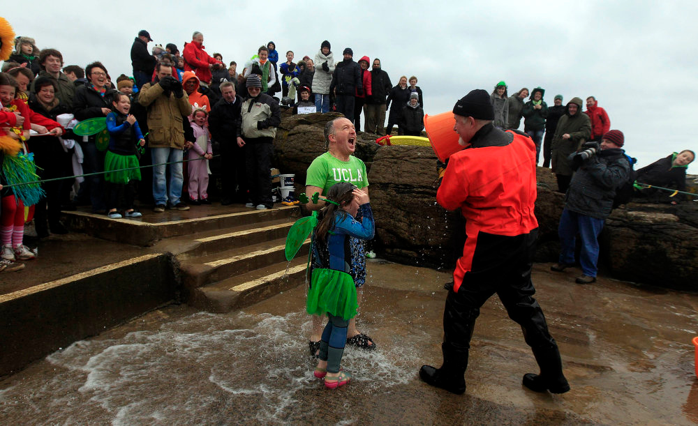 . People in fancy dress react after getting water thrown over them in a charity event to celebrate Saint Patrick\'s Day and raise money for local charities in the town of Portstewart, County, Londonderry on March 17, 2013. REUTERS/Cathal McNaughton