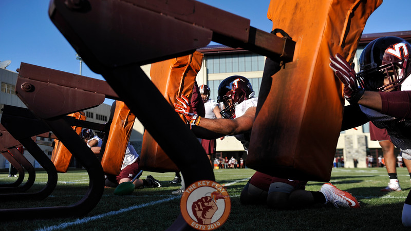Virginia Tech Hokies defensive linemen get some reps on the blocking sled. (Michael Shroyer/ TheKeyPlay.com)