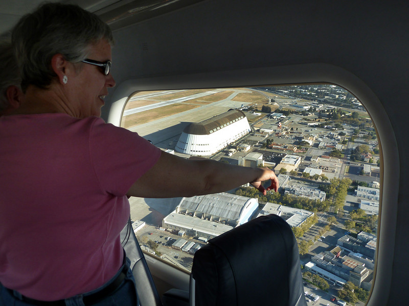 """A """"regular"""" pointing out one of the NASA wind tunnel buildings below."""