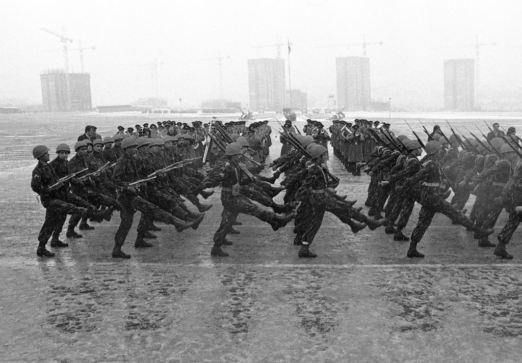 """. Army units goose step on a parade ground near Niavaran Palace as the Iranian Army shows her strength on Tuesday, Jan. 23, 1979 in Tehran. Officers of the crack units asserted, that they were ready \""""to shed their blood\""""  for the monarch and the civilian government. (AP Photo/Saris)"""