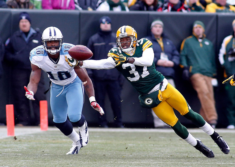 . Green Bay Packers cornerback Sam Shields intercepts the ball from Tennessee Titans wide receiver Kenny Britt (L) during the first half of a NFL football game in Green Bay, Wisconsin December 23, 2012. REUTERS/Darren Hauck