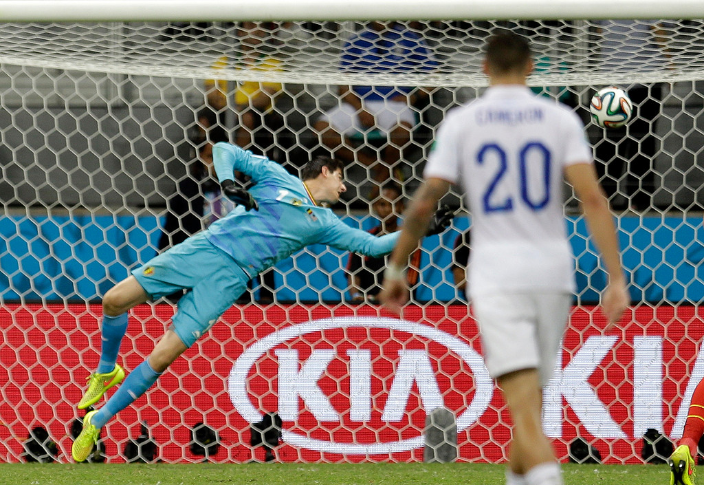 . Belgium\'s goalkeeper Thibaut Courtois can not stop a shot by United States\' Julian Green as he scored his side\'s first goal in extra time during the World Cup round of 16 soccer match between Belgium and the USA at the Arena Fonte Nova in Salvador, Brazil, Tuesday, July 1, 2014. (AP Photo/Natacha Pisarenko)