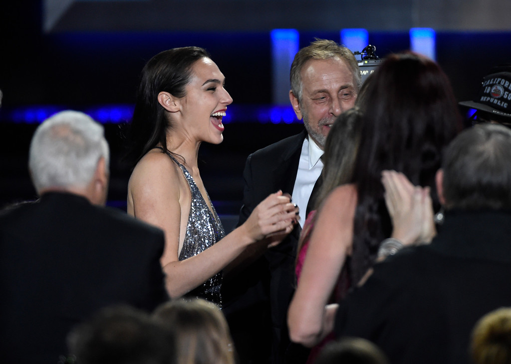 ". Gal Gadot reacts in the audience as ""Wonder Woman\"" wins for best action movie at the 23rd annual Critics\' Choice Awards at the Barker Hangar on Thursday, Jan. 11, 2018, in Santa Monica, Calif. (Photo by Chris Pizzello/Invision/AP)"