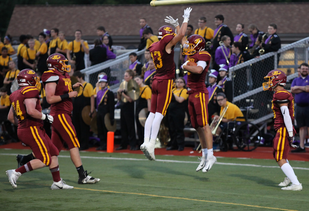 . Randy Meyers - The Morning Journal<br> Nathan Sidloski of Avon Lake is congratulated by his teamates after scoring a first quarter touchdown against Avon on Sept. 7.