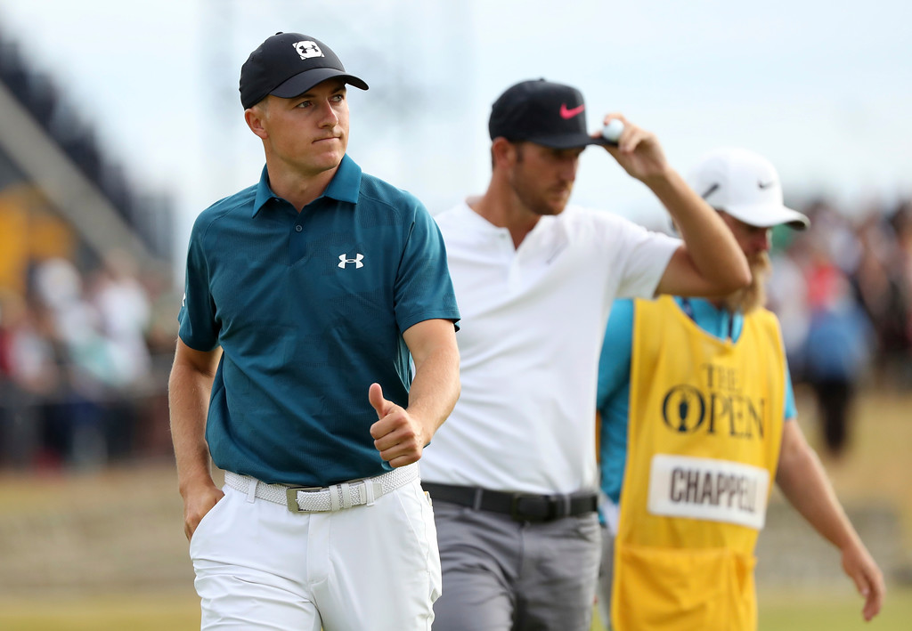 . Jordan Spieth of the US, left, and Kevin Chappell of the US finish the third round of the British Open Golf Championship in Carnoustie, Scotland, Saturday July 21, 2018. (AP Photo/Peter Morrison)
