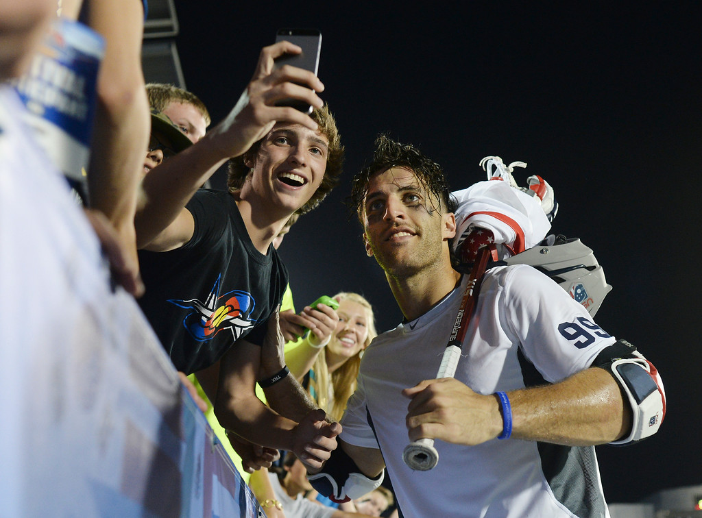 . A fan took a selfie with United States midfielder Paul Rabil after the match. The United States defeated Canada 10-7 in the opening game of the FIL World Lacrosse Championships Thursday night, July 10, 2014.   Photo by Karl Gehring/The Denver Post