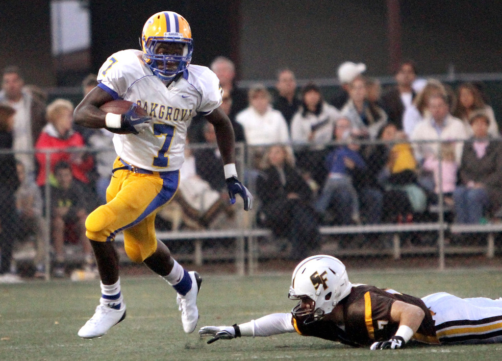 . <p>13. CHIDOBE AWUZIE � DEFENSIVE BACK � OAK GROVE</p> Awuzie (7) breaks a tackle against  St. Francis\' J.T. Bognanno in the first quarter during a game at St. Francis High School in Mountain View on Friday, August  30, 2012. (Kirstina Sangsahachart/ Daily News)