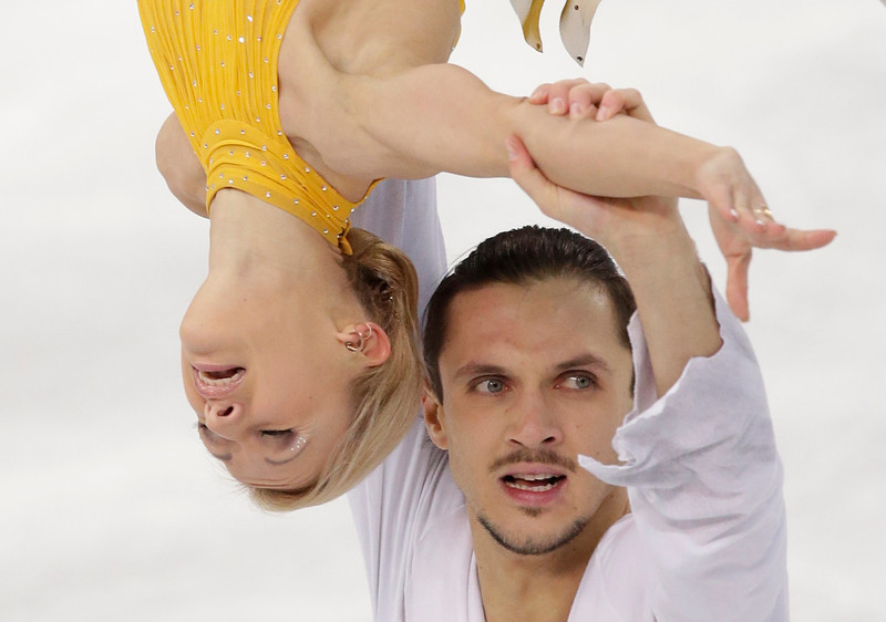 . Tatiana Volosozhar and Maxim Trankov of Russia compete in the pairs free skate figure skating competition at the 2014 Winter Olympics, Wednesday, Feb. 12, 2014, in Sochi, Russia. (AP Photo/Bernat Armangue)