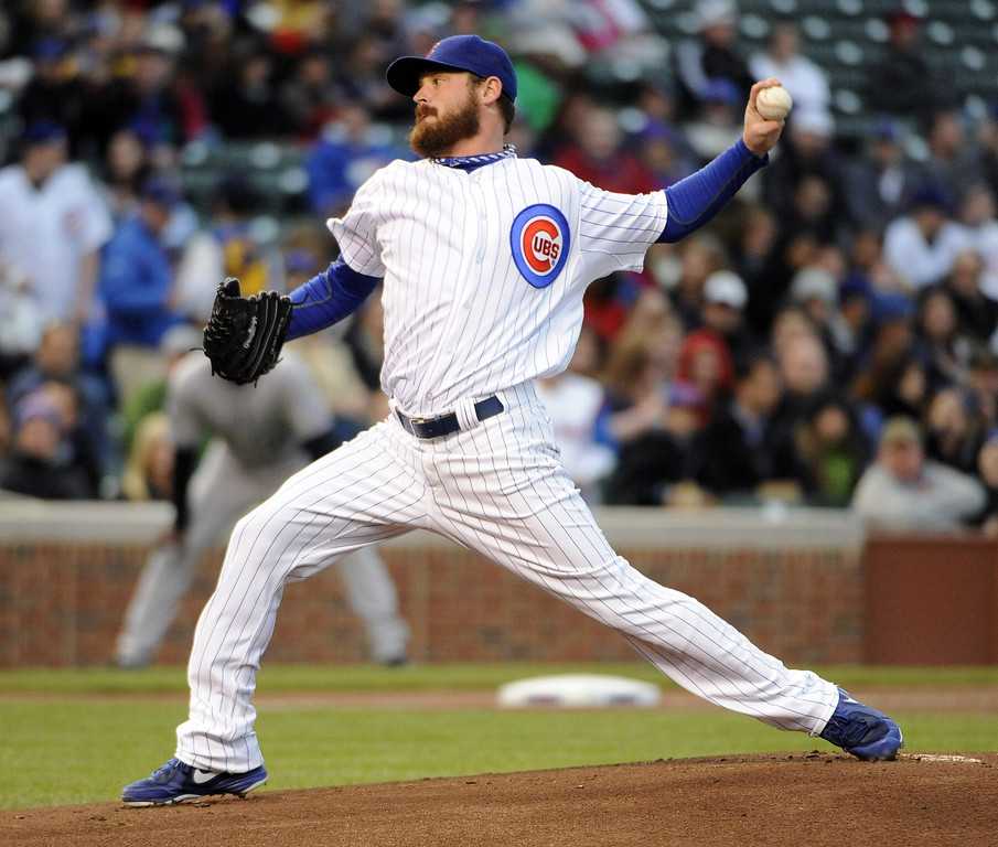 . Travis Wood #37 of the Chicago Cubs pitches against the Colorado Rockies during the first inning on May 13, 2013 at Wrigley Field in Chicago, Illinois.   (Photo by David Banks/Getty Images)