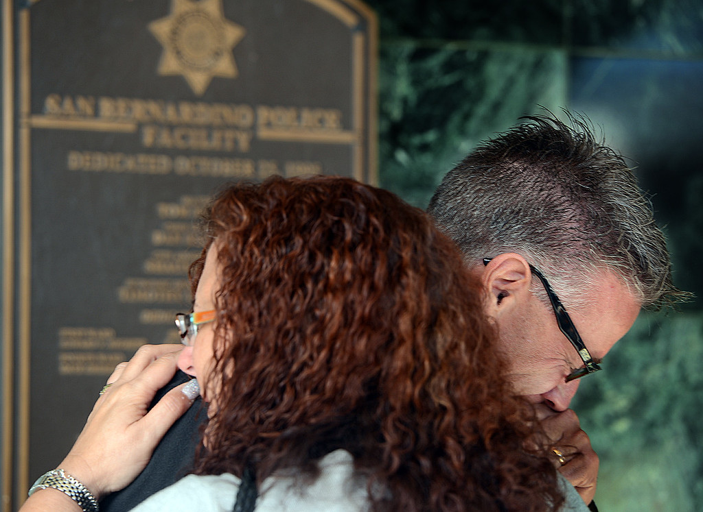 . The parents of Ashley Atherley, Lucia Robles and Scott Hall of Tampa Florida, break down in tears following a press conference where they talked about their daughter. San Bernardino police are searching for Edly Atherley, 33, of San Bernardino, for questioning in the stabbing and beating death of his wife, Ashley Atherley, 28. (Staff photo by Rick Sforza/The Sun)